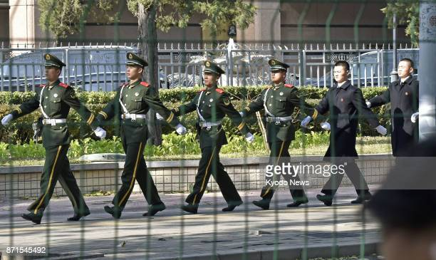 Armed police patrol on Nov 8 near a hotel in Beijing where US President Donald Trump will stay during his visit to China as part of his fivenation...