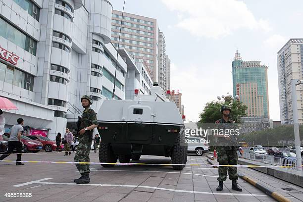 Armed police patrol on the street in Urumqi the capital of northwest China's Xinjiang Uygur Autonomous Region which is under a severe security...