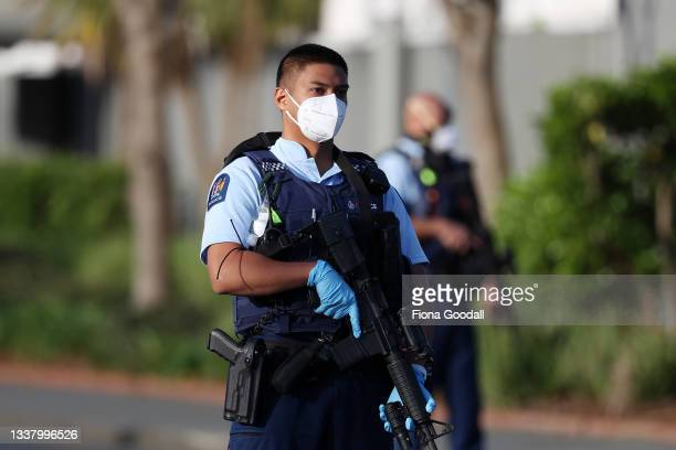 Armed police patrol the area around Countdown LynnMall after a mass stabbing incident on September 03, 2021 in Auckland, New Zealand. A man has been...