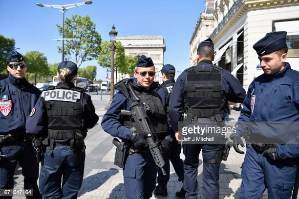 Armed police patrol the Champs Elysees in Paris following yesterdayÕs shooting of a police officer on April 21 2017 One police officer was killed and...