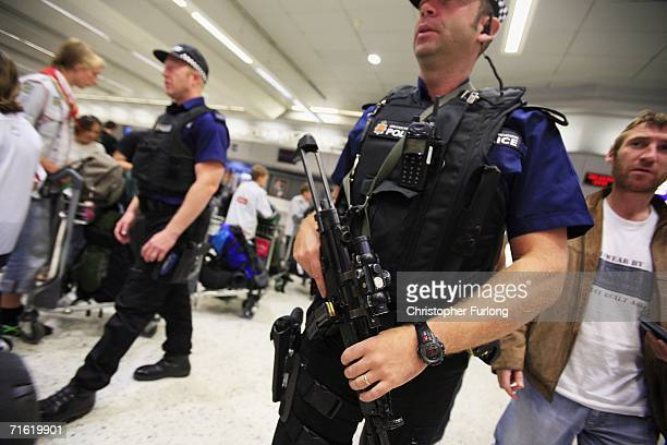 Armed police patrol the departure lounge of Manchester Airport on August 10, 2006 in Manchester, England. British airports have been thrown into...