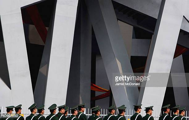 Armed Police patrol the National Stadium known as the 'Birdsnest' prior to tommorows Beijing Paralympic Games Opening ceremony at the National...