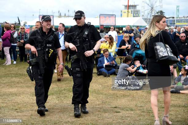 Armed police patrol the public area for the British DDay Commemoration on June 05 2019 in Portsmouth England The political heads of 16 countries...