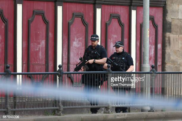 Armed police patrol the streets the morning after a terrorist attack on May 23 2017 in Manchester England An explosion occurred at Manchester Arena...