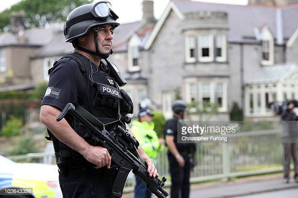 Armed police patrol the village of Rothbury as the search for armed fugitive Raoul Moat goes on in the north-east of the country on July 6, 2010 in...