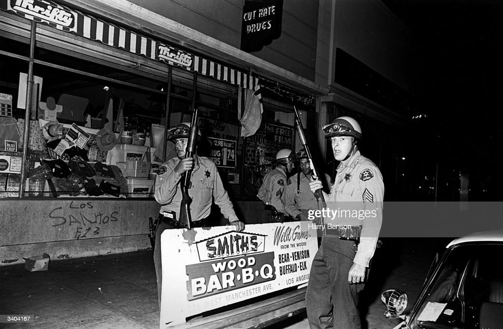 Armed police patrolling the streets of Los Angeles during the Watts race riots, 11th-15th August 1965.