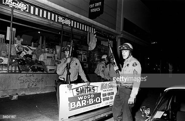 Armed police patrolling the streets of Los Angeles during the Watts race riots 11th15th August 1965