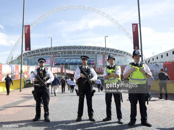 Armed police presence outside Wembley Stadium during the FA Cup final match between Arsenal FC and Chelsea FC on May 27 2017 in London United Kingdom