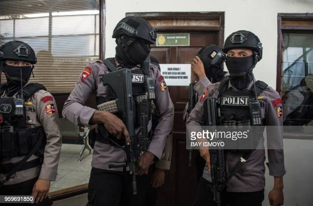 Armed police provide security ahead of a court hearing for the prosecutors' recommendation for Aman Abdurrahman leader of the Islamic State group...