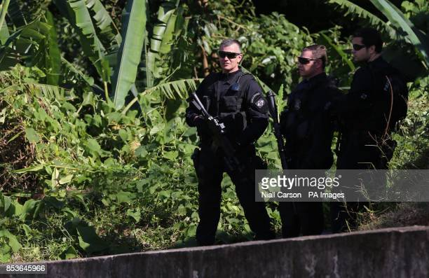 Armed police provide security as Prince Harry plant a tree at Cota 200 outside Sao Paolo where he also viewed Mata Atlantica the Atlantic Rainforest...
