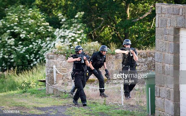 Armed police raid a cottage on the outskirts of Rothbury in the continued search for Raoul Moat, in Rothbury, northeast England on July 7, 2010....