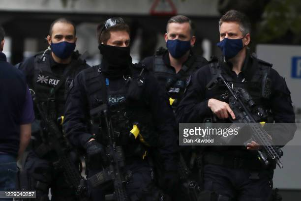 Armed police respond to an incident at St Thomas' Hospital on October 13, 2020 in London, England. Police blocked roads heading toward the hospital...