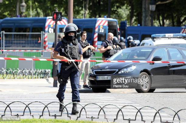 Armed police secure the area after a car smashed into a police van at Avenue Des Champs Elysees on June 19 2017 in Paris France Police evacuated the...