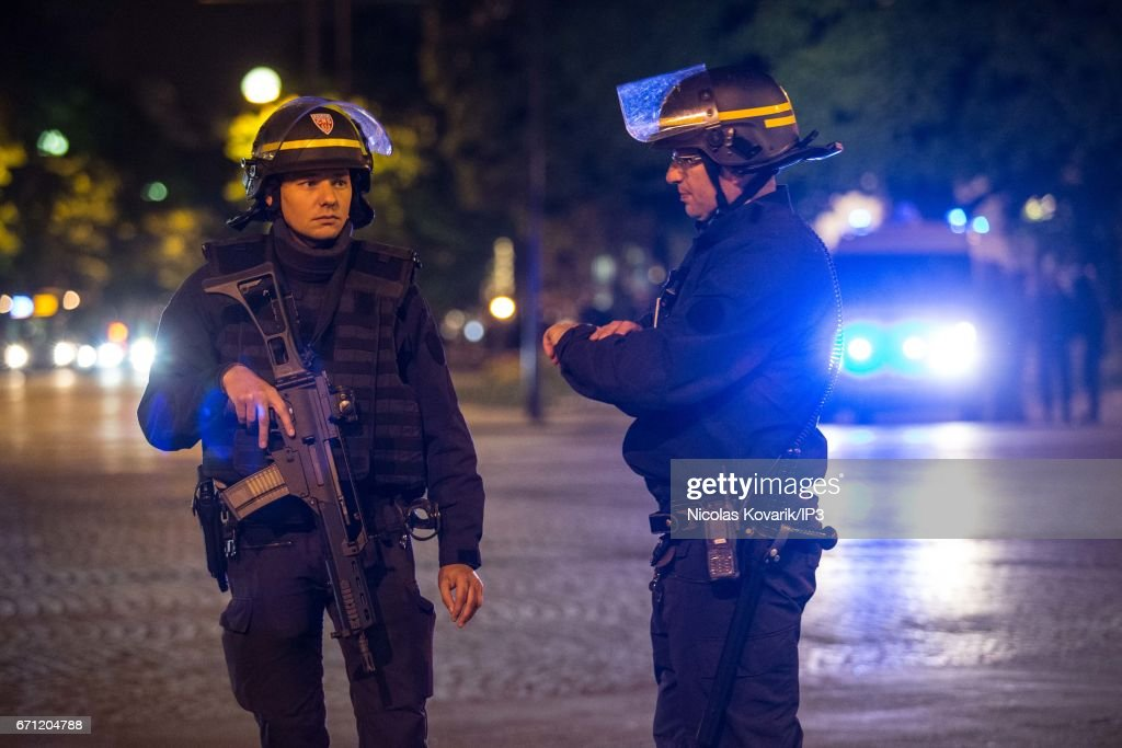 Armed police secure the area after a shooting on the Champs Elysees' avenue on April 20, 2017 in Paris, France. One police officer was killed and another wounded in a shooting on Paris's Champs Elysees, police said just days ahead of France's presidential election. France's interior ministry said the attacker was killed in the incident on the world famous boulevard that is popular with tourists.