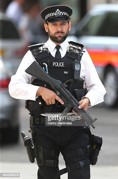 Armed police secure the area before the Queen attends the 70th anniversary of VJ Day Service of Commemoration at St MartinintheFields on August 15...