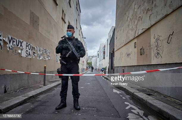 Armed police secure the area of around the former Charlie Hebdo headquarters, and scene of a previous terrorist attack in 2015, after two people were...