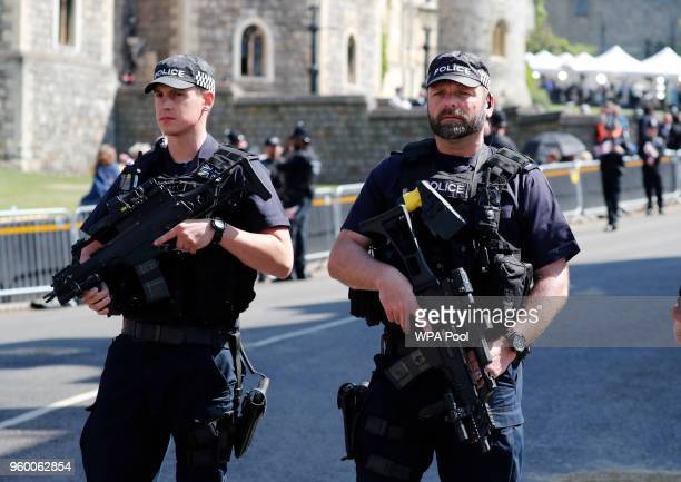 Armed police secure the route of the carriage procession prior to the wedding ceremony of Prince Harry and Meghan Markle at St George's Chapel in...