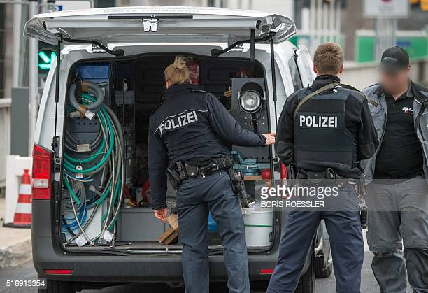 Armed police secures the access to the terminal area of the Frankfurt Airport on March 22 in Frankfurt western Germany The increased security comes...