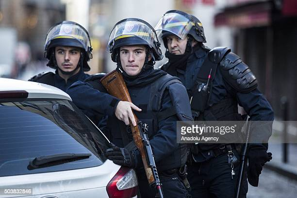 Armed police stand guard after a man was shot dead by police on January 7 2016 in Paris France French A man was shot dead in Paris on Thursday after...
