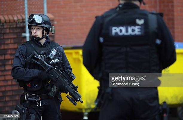 Armed police stand guard as Dale Cregan arrives in an armed convoy to face charges of murder and attempted murder at Preston Crown Court on February...