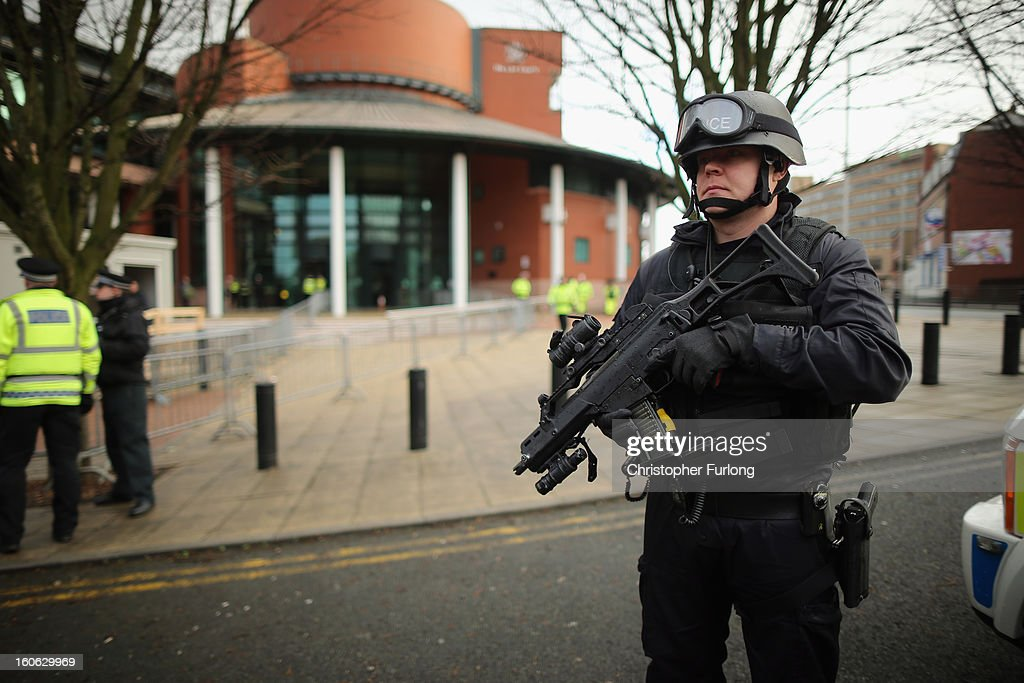 Armed police stand guard as the trial of Dale Cregan, who faces charges of murder and attempted murder, starts at Preston Crown Court on February 4, 2013 in Preston, England. Dale Cregan, 29, stands accused of four murders, including PC Nicola Hughes and PC Fiona Bone on September 18, 2012 and also in two separate attacks earlier this year of Mark Short and his father David Short. Cregan is also being charged with an additional four counts of attempted murder.