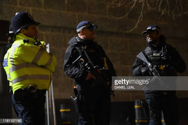 Armed police stand guard as they prepare for New Year celebrations in central London on December 31 2019
