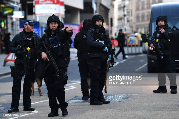 Armed police stand guard at Cannon Street station in central London on November 29 2019 after reports of shots being fired on London Bridge The...