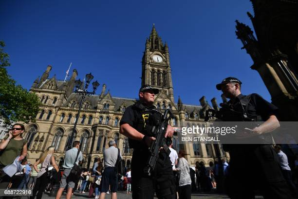 Armed police stand guard in front of the Town Hall in Albert Square during the GreatCity Games in central Manchester northwest England on May 26 2017...