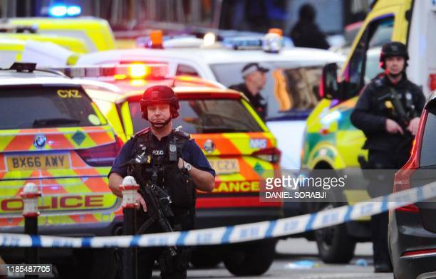 Armed police stand guard near The Monument in London on November 29 2019 after reports of shots being fired on London Bridge The Metropolitan Police...