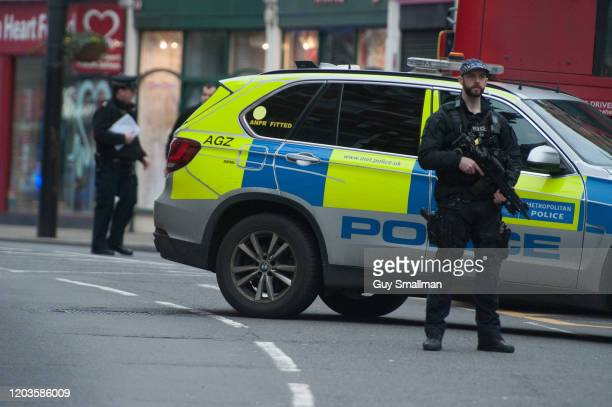 Armed Police stand guard near the scene of the shooting after a man was shot and killed by armed police on February 2 2020 in London England The...