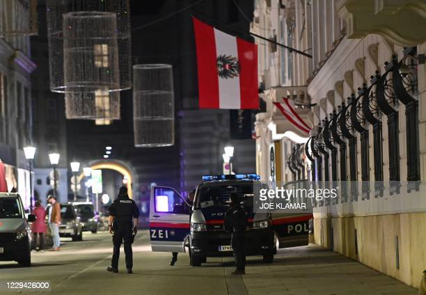 Armed police stand guard outside the Interior Ministry in the center of Vienna on November 2 following a shooting. - Two people, including one...