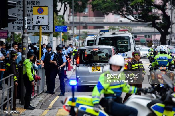 Armed police stand guard shortly after the arrival of a prison van transporting Ramanjit Singh an Indian national on Interpol's global watch list to...