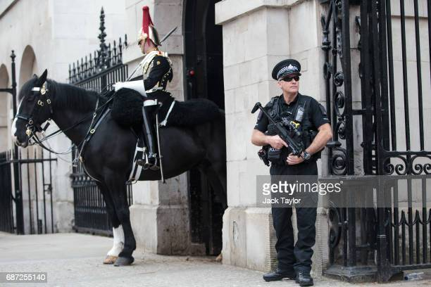 Armed police stand on patrol in Whitehall on May 23 2017 in London England 22 people including children have been killed and 59 injured in an...