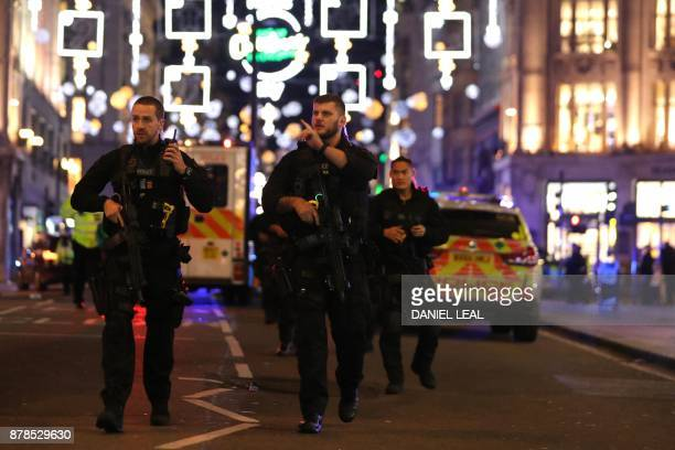 Armed police walk down Oxford Street in central London on November 24 as police responded to an incident British police said they were responding to...