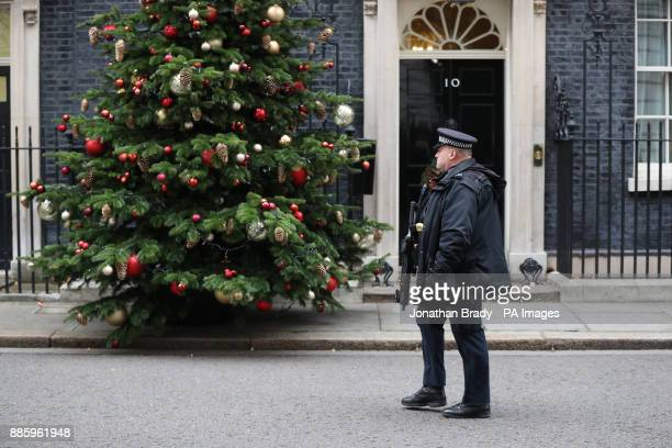 Armed police walk past 10 Downing Street London