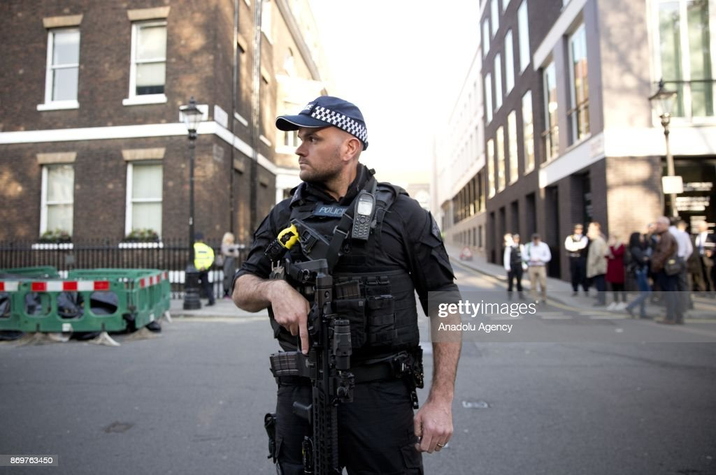 Armed police watch over Israeli supporters and Palestinian protestors as Israeli Prime Minister Benjamin Netanyahu arrives to Chatham House in London, England, where the PM is to deliver a speech on November 3, 2017, as part of his trip to the Britain.