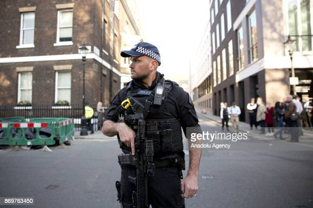 Armed police watch over Israeli supporters and Palestinian protestors as Israeli Prime Minister Benjamin Netanyahu arrives to Chatham House in London...