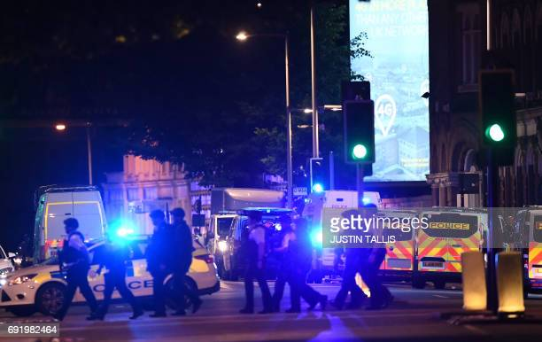 Armed police work at the scene of a terror attack in central London on June 3 2017 Armed police opened fire during what they described as a...