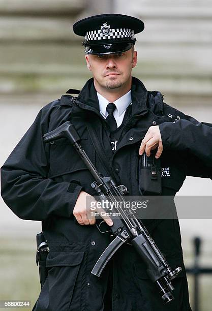 Armed policeman carrying an automatic weapon London England United Kingdom