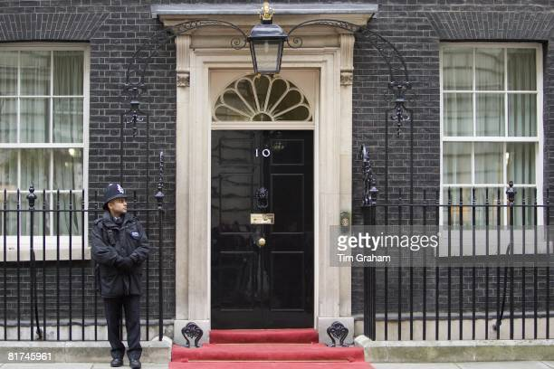 Armed policeman guards Number 10 Downing Street official home of the British Prime Minister London UK