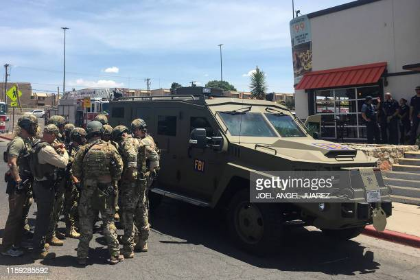 Armed Policemen gather next to an FBI armoured vehicle next to the Cielo Vista Mall as an active shooter situation is going inside the Mall in El...