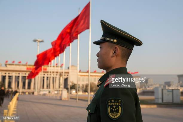 A armed policemen patrol for two sessions at Tian'anmen Square on March 2 2017 in Beijing China The Fifth Session of the 12th National Committee of...
