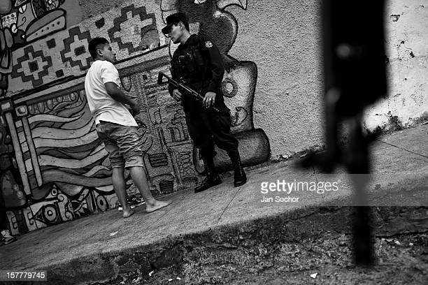 Armed policemen patrol in the gang neighborhood in San Salvador, El Salvador, 12 May 2011. During the last two decades, Central America has become...