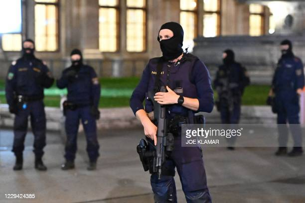 Armed policemen stand guard in front of the state opera in the center of Vienna on November 2 following a shooting. - Two people, including one...