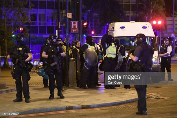Armed policeprep up in Borough on June 3 2017 in London England Police have responded to reports of a van hitting pedestrians on London Bridge in...