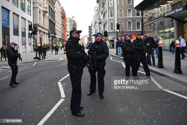 Armed policman stand guard at Cannon Street station in central London on November 29 2019 after reports of shots being fired on London Bridge The...