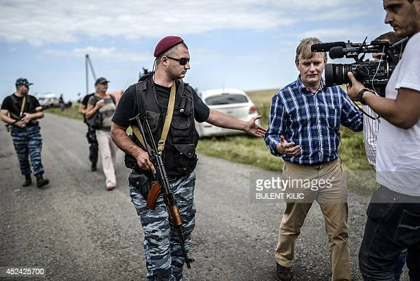 Armed proRussian separatists block the way to the crash site of Malaysia Airlines Flight MH17 near the village of Grabove in the region of Donetsk on...