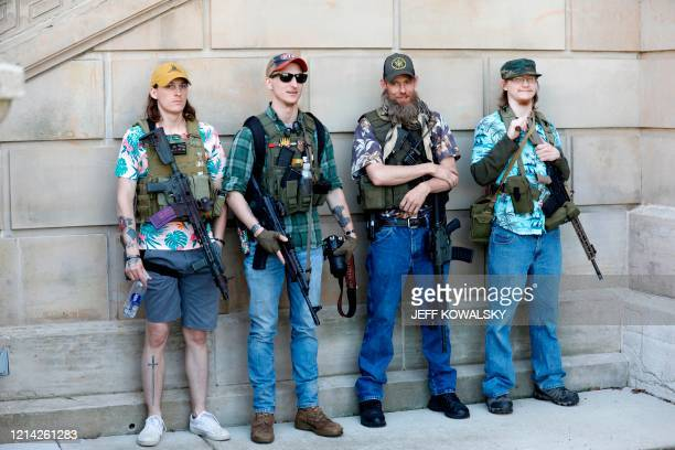 """Armed protesters demonstrate during the Michigan Conservative Coalition organized """"Operation Haircut"""" outside the Michigan State Capitol in Lansing,..."""