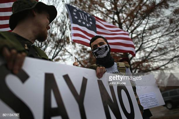 Armed protesters from the socalled Bureau of AmericanIslamic Relations stage a demonstration in front of the Islamic Association of North Texas at...