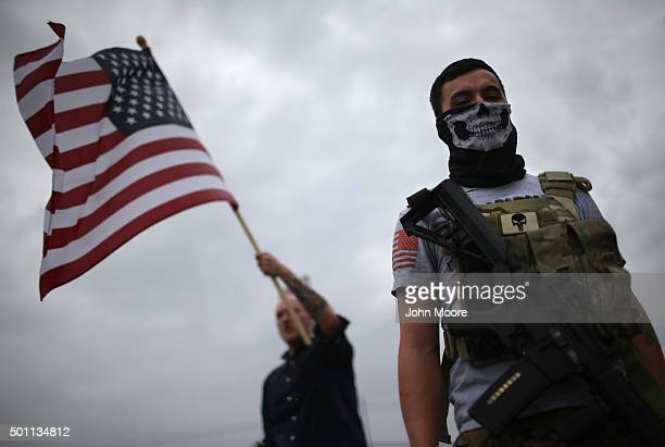 Armed protesters from the so-called Bureau of American-Islamic Relations , stage a demonstration in front of the Islamic Association of North Texas...